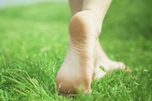 feet walking through the grass