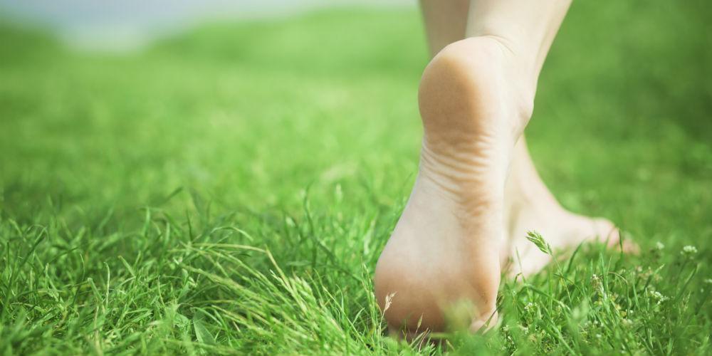 feet walking through grass
