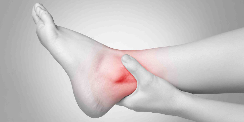 black and white foot with red ankle pain